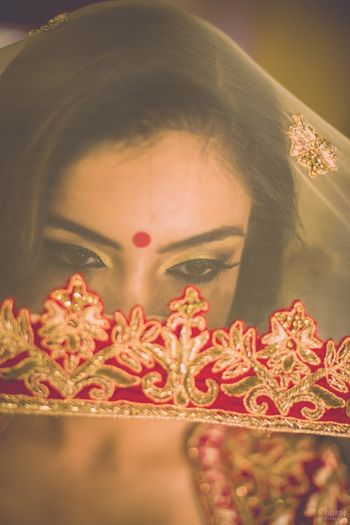 Photo of Bride in Veil - Cream and Red Dupatta