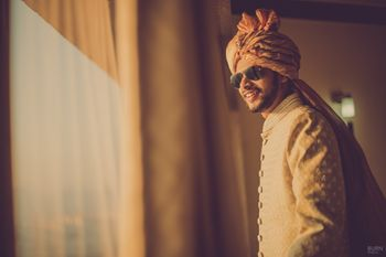 Photo of Groom wearing Aviators Candid Portrait