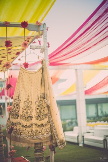 Photo of Gold bridal lehenga with bronze embroidery