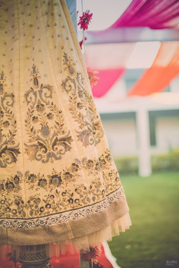 Photo of Cream Lehenga with Gold Self Print