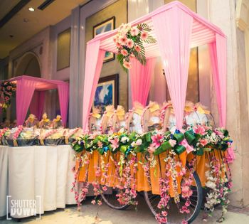 A hand cart decorated with flowers to make unique wedding prop.