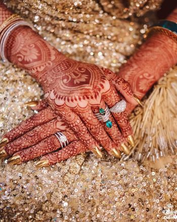 Portrait of a bride wearing stunning diamond rings.