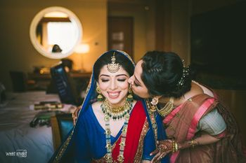 Candid shot of a bride with her mother.