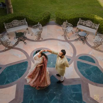 A beautiful shot of the couple caught dancing and twirling.