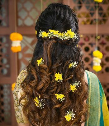 An open hairstyle with baby's breath and small yellow flowers