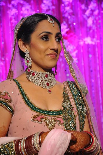 Photo of Bride in Pastel Pink and Green Lehenga