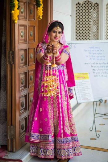 Hot Pink Lehenga with Blue Border and Gold Kaleere