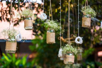 Hanging Mason Jars with Flowers and Burlap Sacs Decor