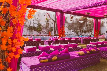 Photo of Purple Low Seating Decor with Fall Leaves for Mehendi