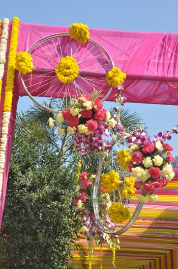 Photo of wheels with flower arrangements
