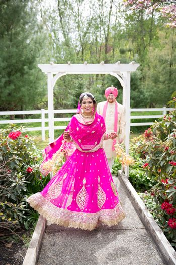 Fuchsia Pink and Gold Border Lehenga