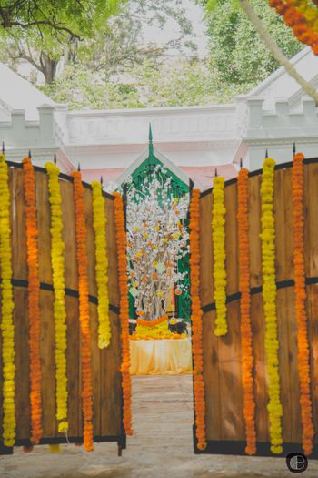 Photo of Orange and Yellow Genda Phool Entrance Decor
