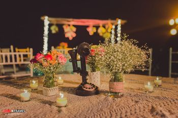 Dim Candles Table Decor with Floral Centerpiece