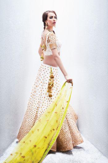 Photo of White and Gold Lehenga with Yellow Dupatta
