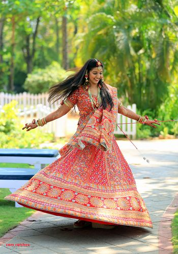 Photo of Coral Red and Gold Twirling Lehenga