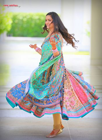 Photo of Blue, Green and Pink Printed Twirling Lehenga