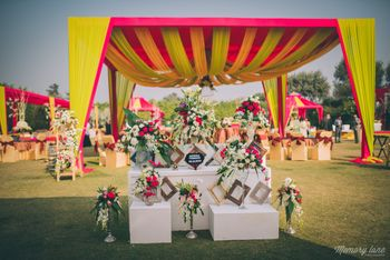 Photo of Red and Yellow Text with Photobooth Decor