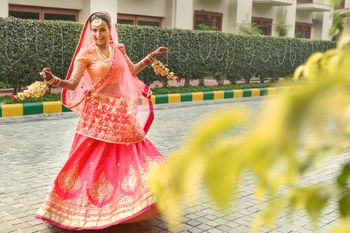 Photo of Hot Pink Shaded Twirling Lehenga with Gold Work