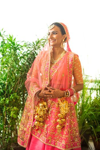 Photo of Pastel Pink Shaded Lehenga with Gold Kaleere