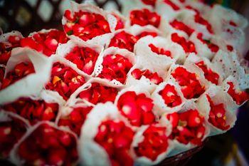 Rose petals in paper cones