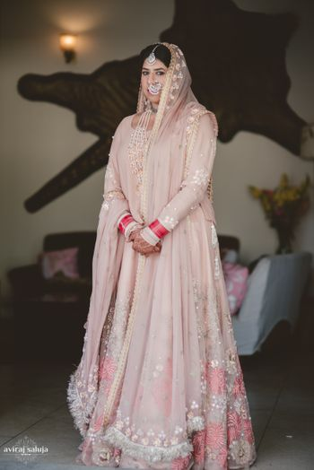 Pastel Peach Lehenga with Blush Pink Motifs