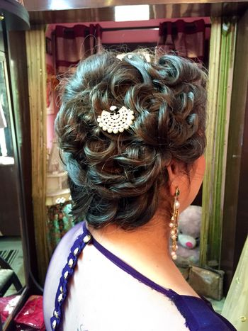 Bun with tied up curls for sangeet or engagement