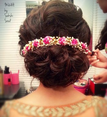 Broad bun with floral hair accessory