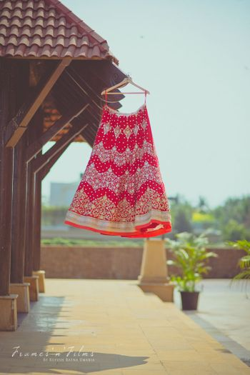Red Lehenga with Silver Motifs on a Hanger