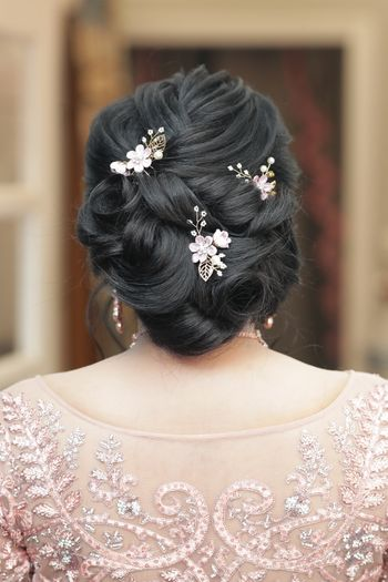 An elegant bun hairstyle for engagement