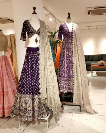 Photo of A bright purple lehenga and a bright purple anarkali  iwth silver detailing