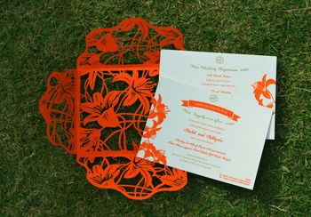 Photo of red laser cut invites