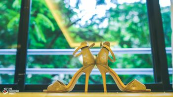 Photo of Wedding heels against window