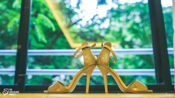 Wedding heels against window