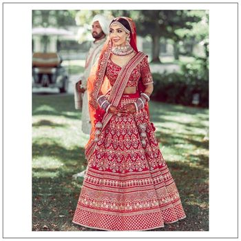 Photo of A beautiful bride of Sabyasachi in statement red lehenga .