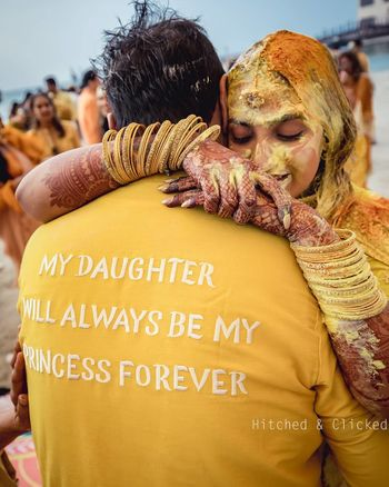 Photo of An emotional moment between the bride and her father on her haldi day.