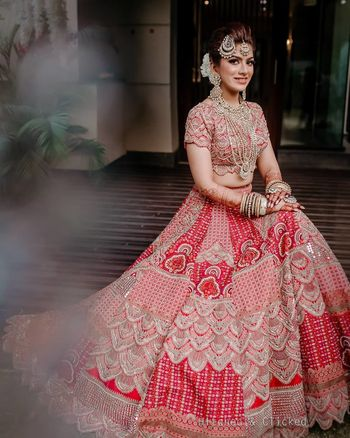 Bride in heavy patchwork lehenga.