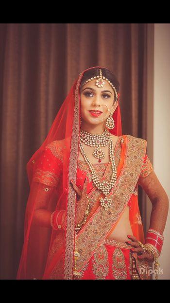 Bride Wearing Orange Lehenga with Kundan Jewellery