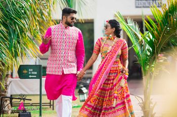 Coordinated bride and groom in pink for the mehendi