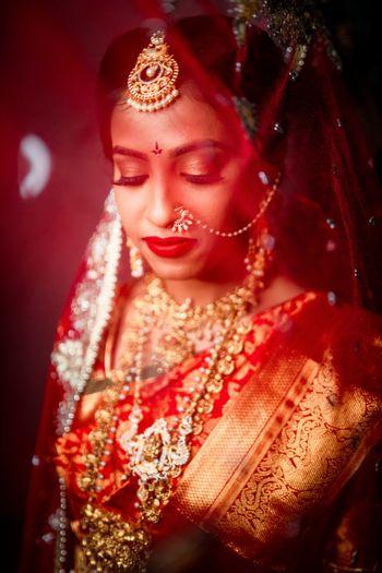 South Indian bride under a veil