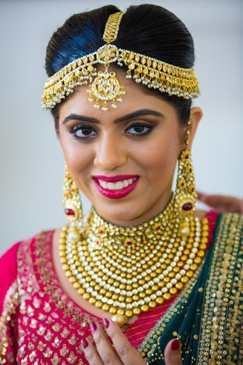 Bride in Traditional Gold Jhoomer, Choker and Earrings