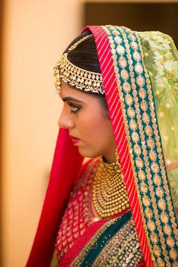 Gold and Pearls Kundan Mathapatti with Matching Choker