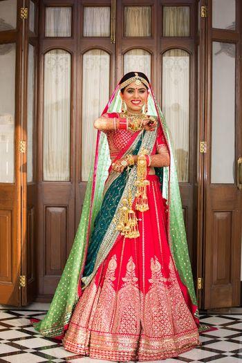 Red and green sabyasachi bridal lehenga