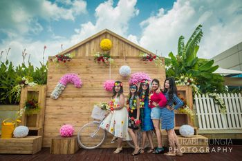 Fun photobooth backdrop with bridesmaids