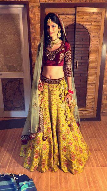 Offbeat bridal lehenga in yellow and maroon