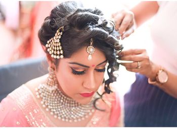 Photo of Bridal Bun with Side Curls and Jhoomer