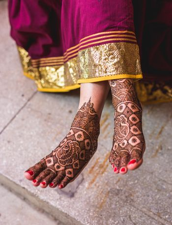 Shot of minimal bridal feet mehndi design
