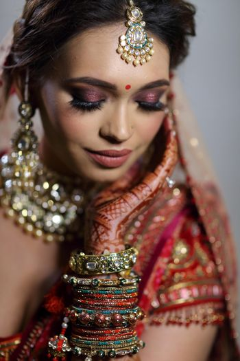 bridal makeup with red pink eyes