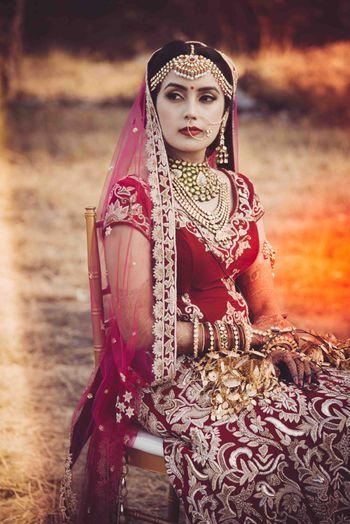 Bride in Maroon Lehenga and Mathapatti