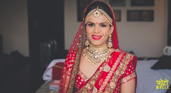 Bride in Red Dupatta and Diamond Jewelry