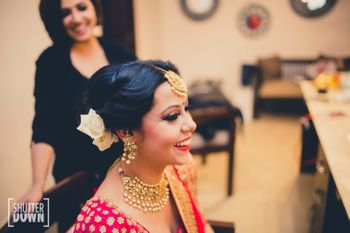 Bride in Gold Maangtikka with White Flowers in Hair
